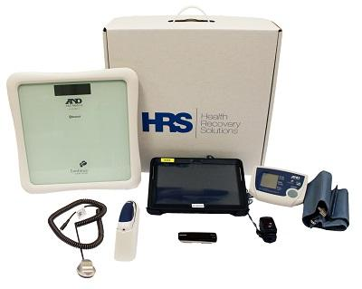 Contents of Health Recovery Solutions kit including digital tablet, blood pressure cuff, and oximeter